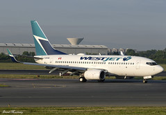 WestJet 737-700 C-GVWJ (birrlad) Tags: dublin dub international airport ireland aircraft aviation airplane airplanes airline airliner airlines airways arrival arriving landing landed runway taxi taxiway sunlight sunrise dawn morning boeing b737 737700 7377ct cgvwj westjet canada toronto stjohns ws16 via