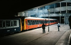 Class 107 DMU @ BIrmingham New Street, 1984 [slide 8442] (graeme9022) Tags: 51990 59802 53857 50857 m50857 derby works br british rail railways strathclyde orange brown livery blue grey standard corporate diesel mechnical multiple unit suburban local regional low density passenger transport transportation 1980s travel railcar mechanical uk train station midlands west scotland