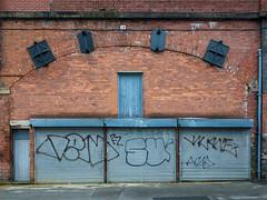 X-I-I-X (Peter.Bartlett) Tags: manchester peterbartlett shutter urban city uk ricohgr urbanarte unitedkingdom facade graffiti wall doorway door colour
