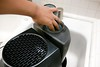 Cleaning the honeywell hev320b humidifier in the kitchen sink (yourbestdigs) Tags: humidifier humidifiers kitchen sink cleaning sponge hand ring diamond white tile water tank