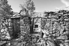 Abandoned cabin, Nye County, Nevada (joeqc) Tags: nevada nv nye fuji black bw blancoynegro blackandwhite white stacked rock cabin fireplace door window monochrome mono greytones
