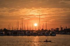 Kayaker at Sunset (Kurt Lawson) Tags: boat boats clouds harbor kayak kayaker laosangeles marina marinadelrey ocean pacific sailboat sailboats summer sun sunset water