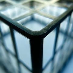rounded corner (vertblu) Tags: latticebox black blue grid lattice gridpattern plastic plasticbox corner geometric geometrical geometry lines linien diagonal vertical closeup dof blurred blur blurry abstractfeel almostabstract anglesanglesangles bluegrey vertblu bsquare 500x500 kwadrat angle perspective