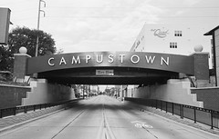 Campustown (dvlmnkillatron) Tags: 35mm film canonf1 champaign sign building underpass campustown road vanishingpoint thequad bw uiuc universityofillinois f1 canon