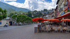 colourful Ascona (Rourkeor) Tags: ascona ticino switzerland ch restaurants people street clouds trees sony sonyrx1r rx1r fullframe carlzeiss zeiss sonnar t 35mm sonyflickraward