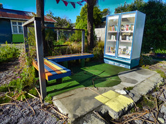 No Need For Silence (Steve Taylor (Photography)) Tags: thinkdifferently library fridge bookexchange gapfiller bunting carpet seat bench fence colourful concrete newzealand nz southisland canterbury christchurch city cbd foundations books cooler