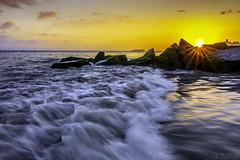 Surf and the peekig sun. (千杯不醉的 drunkcat) Tags: coneyisland brooklyn surf wave sunset peekingsun sunflare rock