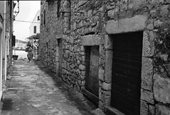 u Murteru.. (gsantar) Tags: film photography mamiya press 23 super sekor 100mm 35 ilford 100 murter croatia goran šantar sonja dog adriatic sea stone house old street