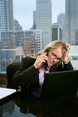 Stressed-Out Businesswoman (perfectionistreviews) Tags: 30s adult anxious business businesssuit businesswoman caucasian city communicating communication conversation corporate desk exhausted fatigue female formalclothing frustration indoors job laptop lifestyle listening occupation office one oneperson overworked person sitting stress stressed telephone tired urban window wireless woman work working computer color photograph vertical anxiety blond building businesspeople technology cityscape connectivity talking multitasking eyeglasses eyewear socialissues