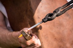 Iron Wolf Forge (Pahz) Tags: blacksmith ironwolfforge kennelson ironwork nails forging iron janesvillerenaissancefaire janesvillewi traxlerpark renaissancefaire renfaire renaissancefairephotographer pattysmithjrf jvl wisconsin