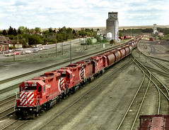 Swift Current SK Wednesday May 19th 1993 1312CST (Hoopy2342) Tags: train rail railroad railway canadianpacific canadianpacificrailway swiftcurrent sask saskatchewan elevator