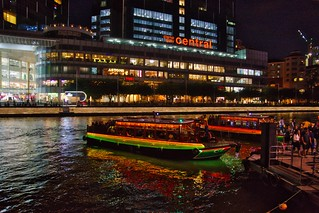 Clarke Quay by the Singapore river with bum boats for tourists