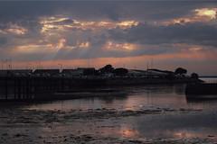 Light Beams. (cbathonewton) Tags: sunset evening seaside landscape atmosphere atmospheric sun sunrays clouds