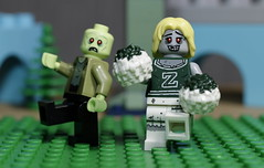 Zombie Cheerleader and friend (N.the.Kudzu) Tags: tabletop lego minifigures zombie cheerleader canondslr canoneflens macro flash
