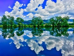 Kreutsee with tree and cloud reflections in Bavaria, Germany (UweBKK (α 77 on )) Tags: lake kreutsee trees clouds sky blue water reflection green nature white outdoors bavaria bayern germany deutschland europe europa iphone