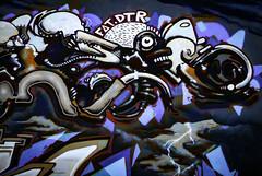 FAT.DTR (Steve Taylor (Photography)) Tags: fat dtr monster alien lightening cloud teeth art digitalart cartoon graffiti mural streetart contrast mauve lilac purple white black bright brown weird crazy mad odd strange newzealand nz southisland canterbury christchurch