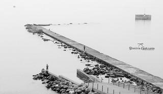 Fishermen figures in a misty morning