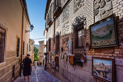 Back streets of Toledo (Marian Pollock) Tags: spain toledo europe street streetscene people paintings balconies cobblestones plates decoration
