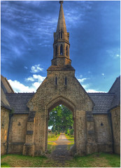 through the arch (andystones64) Tags: chapel ease brigg northlincs northlincolnshire lincolnshire nlincs cemetery trees archway arch architecture spire sky clouds cirrus