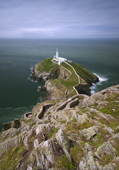 South stack (John Joslin) Tags: anglesey ocean wales sea water clouds lighthouse rocks sony stack steps winding scenic waves longexposure landscape loxia2821 light loxia coast coastal coastline south shoreline outdoors outside overcast outcrop path