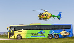 G-SCAA EC135 and Stagecoach bus, Scone (wwshack) Tags: airbushelicopters ec135 egpt eurocopter psl perth perthairport perthshire scaa scone sconeairport scotland scotlandscharityairambulance stagecoach helicopter gscaa