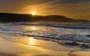 Sunrise Seascape with Sunburst over the Headland (Merrillie) Tags: daybreak sunrise cloudy australia nsw centralcoast clouds sea newsouthwales rocks earlymorning morning water landscape ocean nature sky waterscape coastal seascape outdoors killcarebeach dawn coast killcare waves