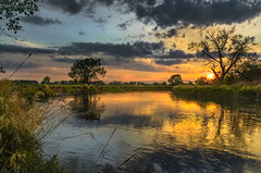 Cloudy spring (piotrekfil) Tags: nature landscape sunlight sun sky clouds river water reflections spring pentax poland piotrfil sunset