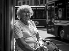Stop The Bus (Leanne Boulton) Tags: portrait urban street candid portraiture streetphotography candidstreetphotography candidportrait streetportrait eyecontact candideyecontact streetlife old elderly woman female eyes face look mood emotion feeling lady backlit sociallandscape public transport bus sitting summer skin wrinkles suntan tone texture detail depthoffield bokeh naturallight outdoor light shade shadow city scene human life living humanity society culture people lifestyle canon canon5d 5dmkiii 70mm ef2470mmf28liiusm black white blackwhite bw mono blackandwhite monochrome glasgow scotland uk