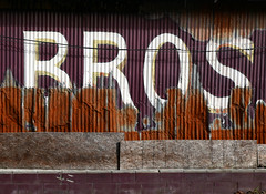 Short for brothers (steverichard) Tags: word sign painted corrugated metal bros brothers business lettering signage texas backroad usa rusty decay