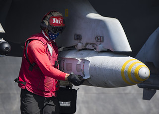 Sailor inspects ordnance prior to launch of an F/A-18 Super Hornet.