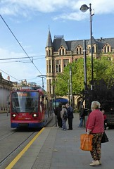 The Tram. (jenichesney57) Tags: tram manchester brilding transport panasoniclumix street road pavement people sheffield sunshine view streetlight lamppassengers 52weekchallenge trees red