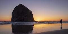 Haystack Rock at Sunset (d-day buff) Tags: cannonbeach haystackrock ocean oregon pacificocean sunset waves man person silhouette reflection