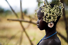 Surma girl - Ethiopia (Steven Goethals) Tags: ethiopia ethiopie ethiopië etiopia tribe tribal portrait girl ethnic nice beautiful ethnology ethnique culture tradition tribo face tribes visage travel human explore east africa people peoples adventure black skin afrique de lest valley goethals steven necklace colorful fuji fujifilm xseries xt2 xf56 surma suri decoration intense look kibish facial flowers