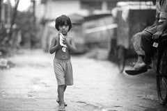 Candid Of A Little Neighbour (N A Y E E M) Tags: girl neighbour candid portrait afternoon ramadan street rabiarahmanlane norahmedroad chittagong bangladesh carwindow