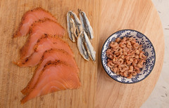 North Sea shrimp, salmon and anchovies. (annick vanderschelden) Tags: shrimp northsea northseashrimp wood bowl lazysusan ivory food fish decapod crustaceans animal decoation peeled raw tasteful flavour salmon smoked smokedsalmon citruspepper pepper cold salmonidae anchovies engraulidae forasgefish belgium