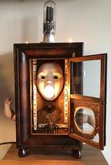 Mother's Little Helper (Vincent Mattina (aka FLUX)) Tags: light lightbulb face woman robot machine tube clock clockwork hands