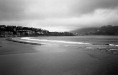 Rainy beach (Gabo Barreto) Tags: sansebastian paisvasco basquecountry beach rain clouds sea water sand chromogenicfilm blackandwhite monochrome analoguephotography olympusstylusepic 35mm pointandshoot ishootfilm filmisnotdead ilford xp2