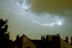 Storm (Geoff Henson) Tags: storm cloud night weather rain roofs aerials tree lightning thunder torrential