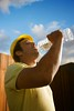 Construction Worker Drinking Water (perfectionistreviews) Tags: 1 20s adult bluecollar bluesky bottledwater break caucasian construction constructionworker copyspace drink drinking hardhat hat health healthylifestyle hydration job jobsite lifestyle male man occupation one oneperson person quench rest stand standing thirsty thrist twenties water waterbottle wellbeing wellness worker industrial industry color photograph vertical bottle brunette buildingsite working hydrate outdoors halflength industryandagriculture