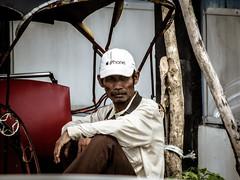 The iPhone I could afford (A. Yousuf Kurniawan) Tags: mudik becak ricksaw people hat cap job work waiting streetphotography humanity colourstreetphotography cinematic banjarmasin