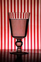 So Far To Go (Caroline.32) Tags: flickrfriday single glass stripes water refration red nikond3200 18140mmlens