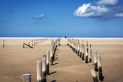 TARIFA/poles in a row (inigolai) Tags: tarifa cadiz andalusia spain españa landscape playa beach paisaje color colors clouds sky perfectcomposition southcoast southspain europe costadelaluz