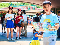 DisneyLand Street Scenes 10 (C & R Driver-Burgess) Tags: disneyland hongkong outside people paths streets clean nostalgia mickey minnie mouse costume ears small toddler preschool girl little snowwhite chasing bubbles two women standing smile boy reading guide pamphlet wonder arch entrance