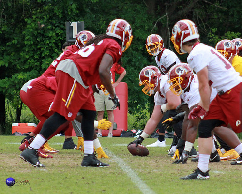 Redskin players set at the line of scrimmage.