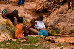 Healing a Sick Child (Rod Waddington) Tags: africa african afrique afrika madagascar malagasy culture cultural child sick water mineral healing belief group father ethnic ethnicity outdoor people