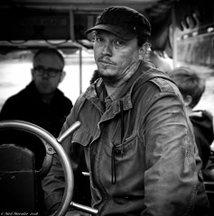 Bristol Ferry (Neil. Moralee) Tags: neilmoralee neilomoralee man face ferry bristol captain driver ferryman portrait dcar fedup bored black white bw bandw blackandwhite neil moralee olympus omd em5 wheel hat boat ship sailor harbour harbor sail trip historic monochrome mono