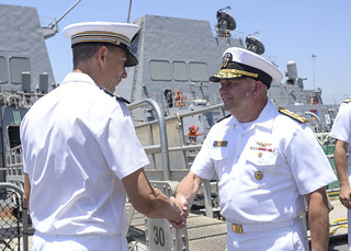ice Adm. John D. Alexander and French navy Capt. Luc Pohl meet to prepare for RIMPAC 2018.