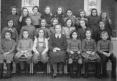 Class photo (theirhistory) Tags: children kids boy girl school pupils group jumper shoes trousers shorts wellies rubberboots teacher dress skirt