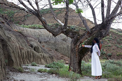 wings of love (OneLifeOnEarth) Tags: onelifeonearth montana makoshika state park ehir 1407 tree badlands feathers gift girl white dress canon self portrait poetry