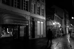 Sometimes I walk through a wet night (gambajo) Tags: 1year1town1lens brühl project blackandwhite blackwhite black white people public outdoors street streetphotography night dark moody lamp alleyway x100s fujix100s fujifilmx100s gasse menschen strase nacht dunkel wet rain regen nass